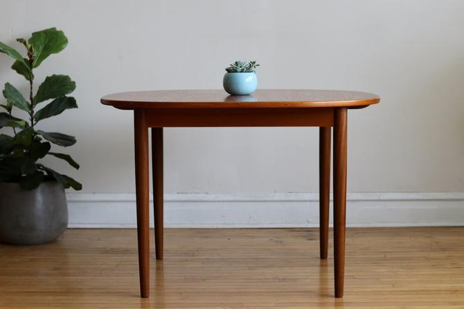 Mid Century Danish Modern Round Teak Table with Butterfly Leaf by SharkGravy