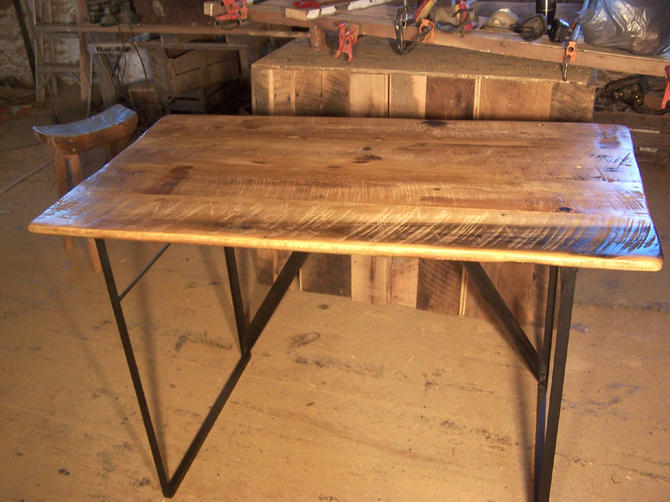 Reclaimed wood standing work desk with industrial metal base by BarnWoodFurniture