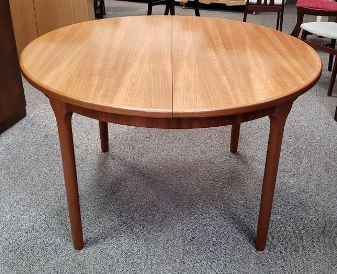 Item #DM16 Mid Century Round Extending Teak Dining Table w/ Butterfly Leaf by McIntosh c.1960s