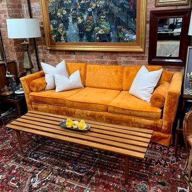 Orange velvet sofa with slatted MCM coffee table
