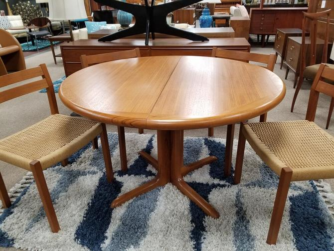 Danish Modern teak dining table with 2 leaves