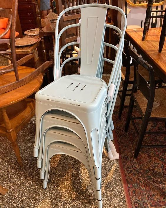Stack of powder blue metal chairs 4 available