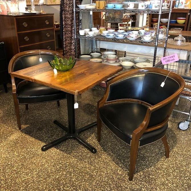 Cafe table $250. black vinyl armchairs $150 each.