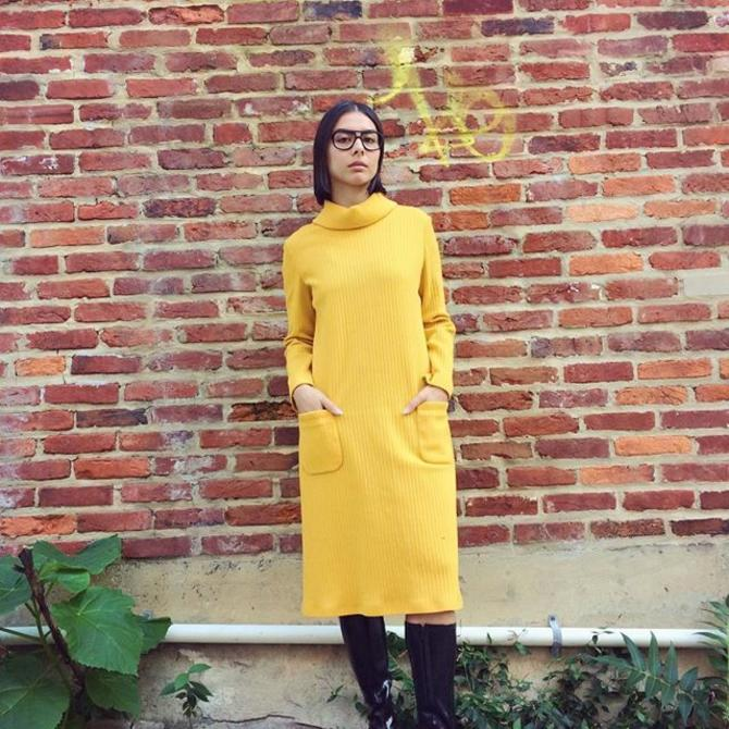 Anna wears knee high rain boots and a yellow turtleneck dress with pockets  #turtleneck #vintageknit #vintagerainboots #mod #retro #meepsdc