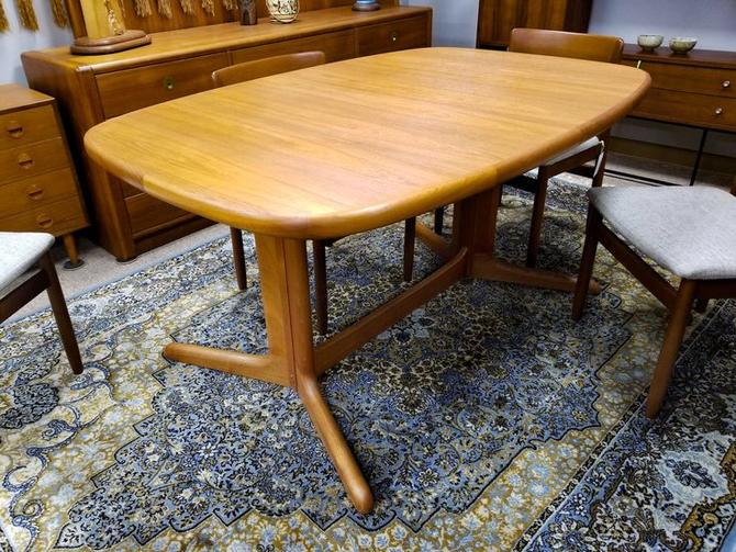 Danish Modern teak dining table with 1 extension
