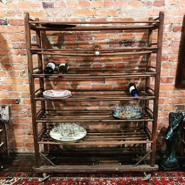 Antique rolling cobblers rack (great for wine storage, dishes, books, etc.)