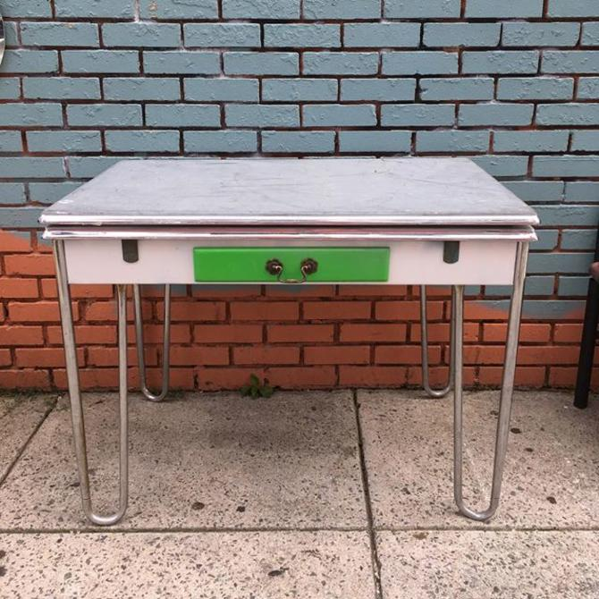 Retro kitchen table with chrome steel hairpin legs and built in extension leaves on both sides. $89. Mom N Pop Antiques