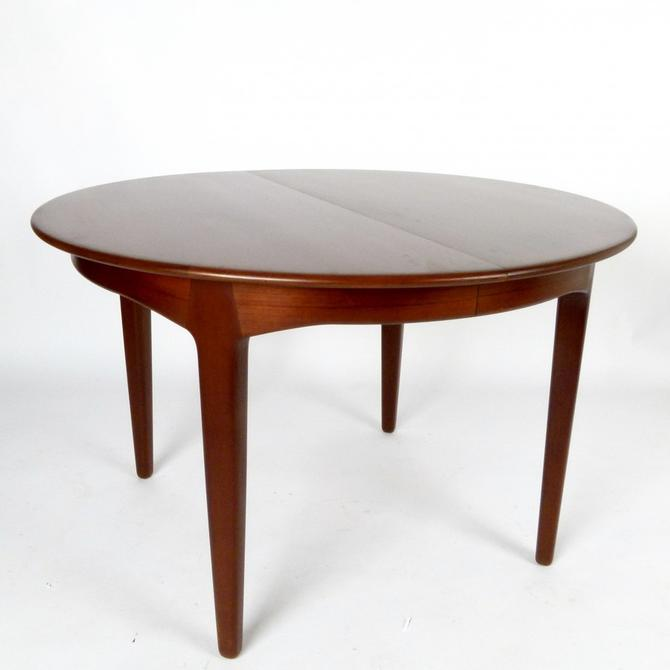 Teak Dining Table With 3 Leaves by Henning Kjaernulf