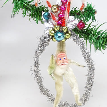 Antique Santa in Tinsel Wreath Christmas Ornament, Hand Painted Clay Face, Chenille Body, Cotton Beard, Faux Feather Tree, Retro by exploremag