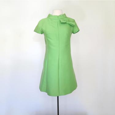 1960s bright green mini dress with mock neck by flutterandecho