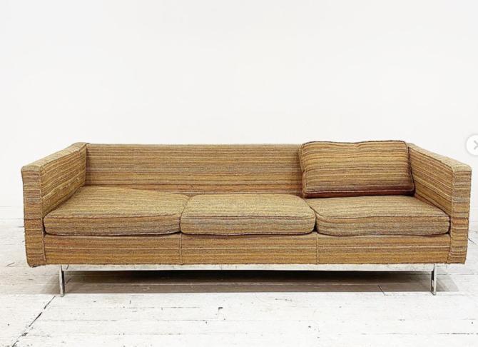Chrome base sofa
