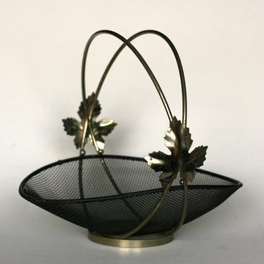 vintage mid century black mesh basket with double handle and leaf detail by suesuegonzalas