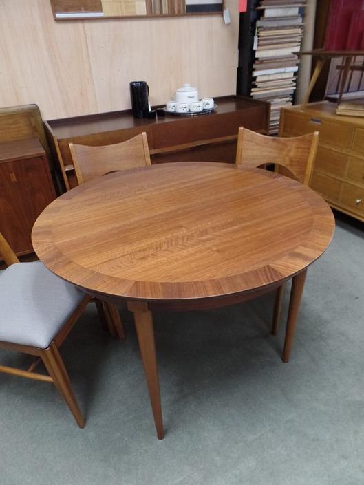 Mid-Century Modern round walnut dining table
