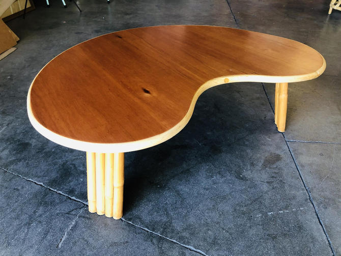 Restored Biomorphic Rattan and Mahogany Coffee Table with Vertically Stacked Legs by HarveysonBeverly