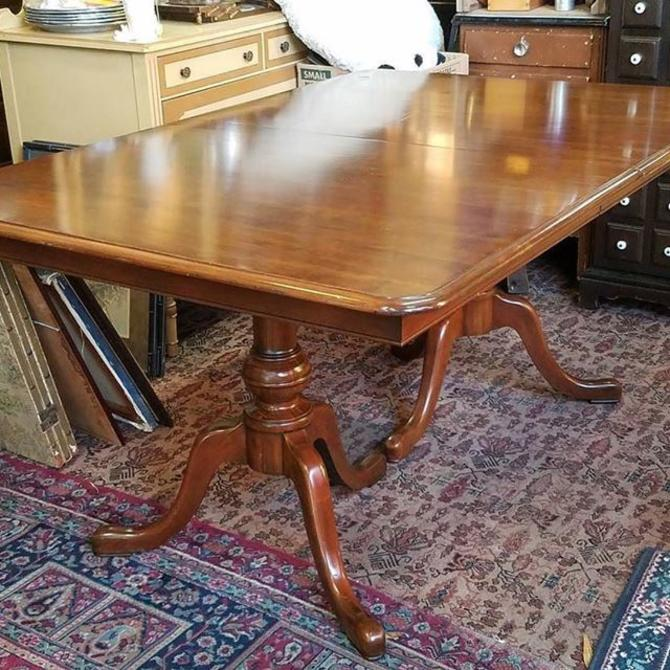 "SOLD. Holiday dining Table, 62 x 42"". Three Leaves and Table Top Cover Pads, expands to 92"". Cherry. $250"