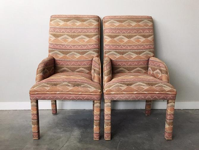 pair of vintage parsons chairs with low arms.