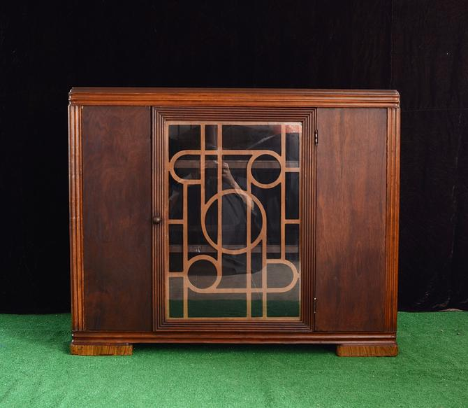vintage Art Deco cabinet with glass door by fingerlickingvintage
