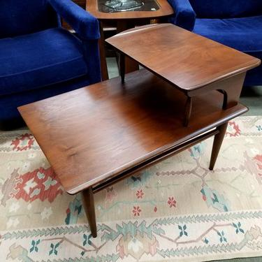 Mid-Century Modern walnut step table with curved edges