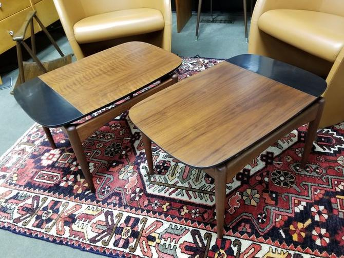 Pair of Mid-Century Modern walnut and black side tables