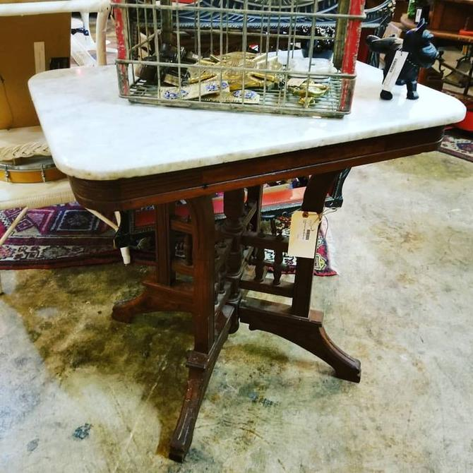 Antique east lake marble top table. $150