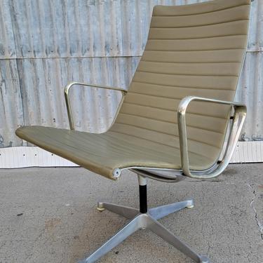 Mid-Century Early Eames Aluminum Group Swivel Chair by JanakosAndCompany