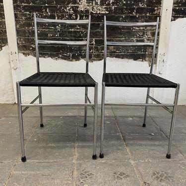 Mid century Italian modern Gio Ponti dining chairs beautiful design chrome back black woven seats set of 2 by symmetrymodern
