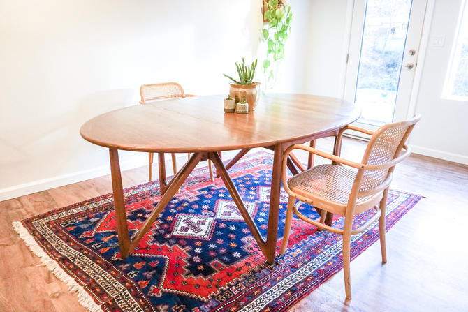 Gorgeous Authentic Danish Mid-Century Modern Solid Teak Wood Expandable Dining Table With Stunning Fold-Out Leg Design by PortlandRevibe