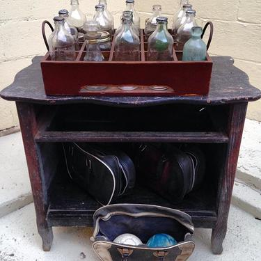 Media stand, old Pepsi bottles, and 3 sets of duckpin bowling balls. Mark it 8, Dude. #vintage #petworth #bowling #homedecor #furniture #pepsi