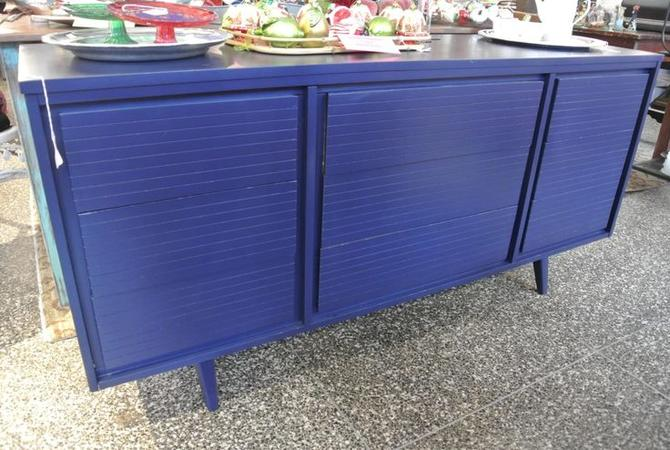 Nine drawer vibrant blue dresser. $595