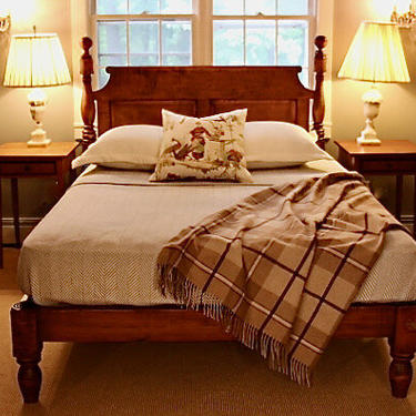 Ball & Bell high-low style bed in tiger maple. Queen size w/ chamfered roll-back raised paneled headboard