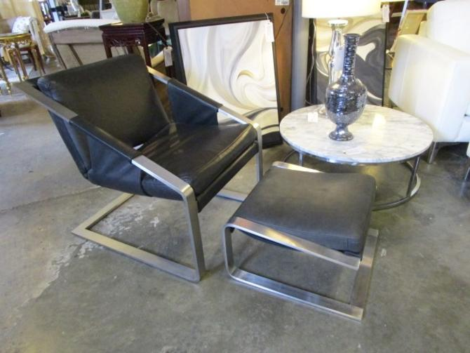 BLACK LEATHER AND ALUMINUM CHAIR AND OTTOMAN
