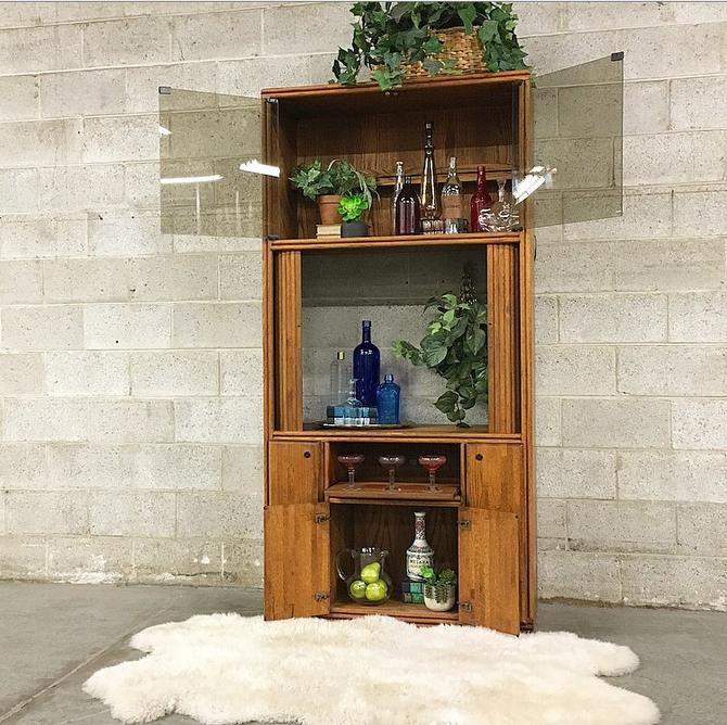 LOCAL PICKUP ONLY Vintage Cabinet Retro 1990s Brown Wood Tinted Glass Front Tv or Bar Cabinet with Accordion Doors + Light Fixture + Drawers by RetrospectVintage215