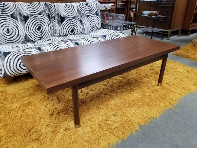 Mid-Century Modern walnut coffee table with brass accents