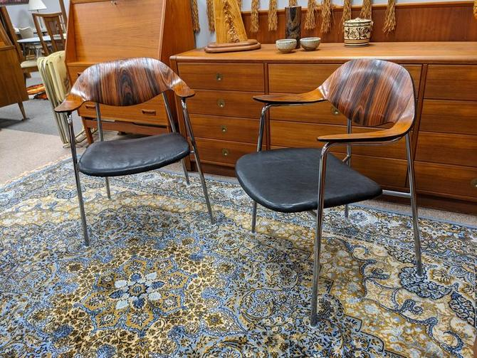 Pair of rosewood and black leather bentwood armchairs by Plycraft