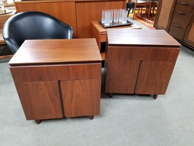 Pair of Mid-Century Modern walnut nightstands by John Stuart
