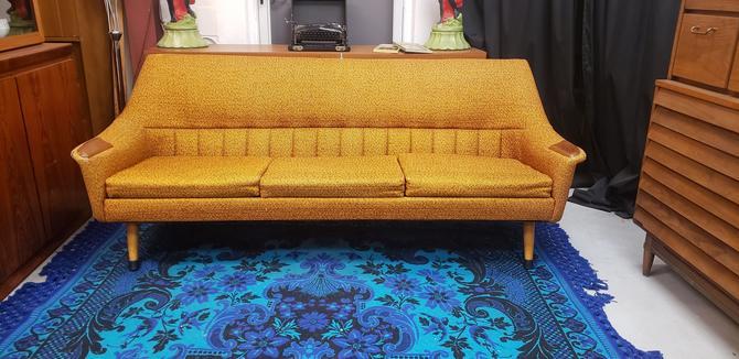 Orange Atomic Mid-century Modern Sofa with Teak Paws
