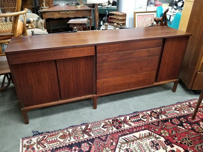 Mid-Century Modern walnut credenza with asymmetrical fronts