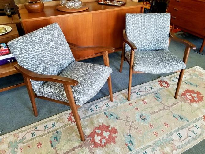 Pair of walnut arm chairs with new grey upholstery
