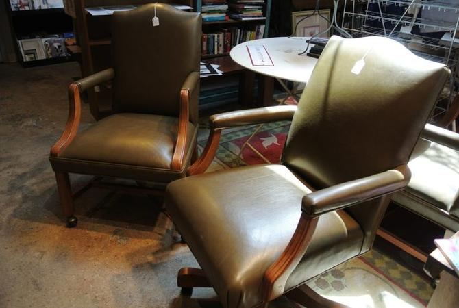 Green leather executive chairs. Two available. $75/each.