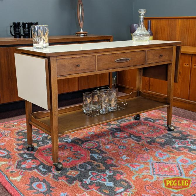 Drop-leaf rolling server/bar cart from the Sculptra collection by Broyhill