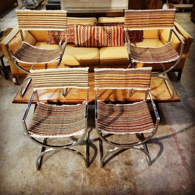 Set of dining chairs, upholstered by Cody Raum. $500.