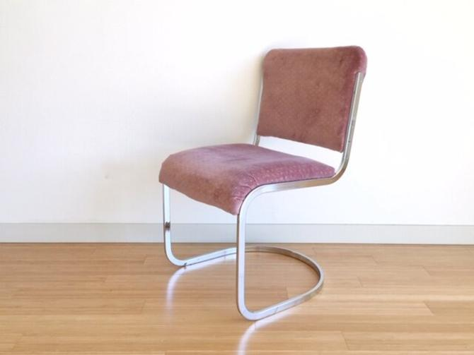 set of 4 vintage mid century modern chrome cantilever chairs in pink.