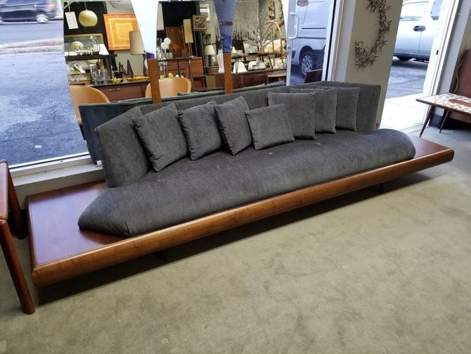 Amazing Mid-Century Modern floating sofa with built-in side tables by Adrian Pearsall