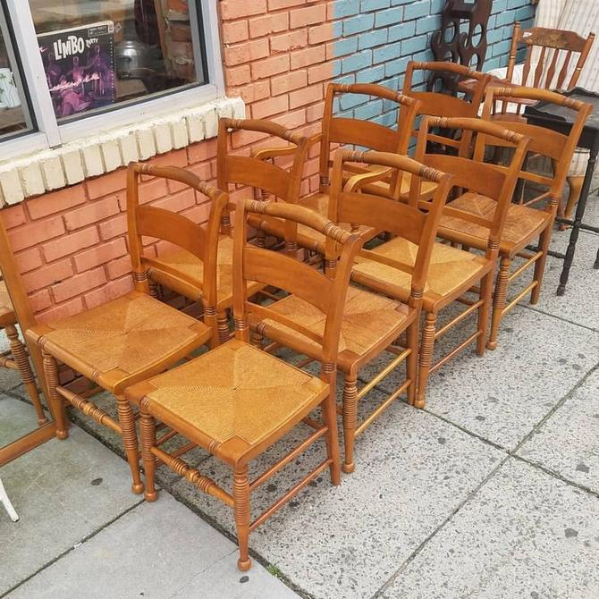 Eight Chairs, Maple with Rush Seats, $290 for all eight.