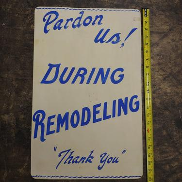 Pardon Us during remodeling hand painted sign