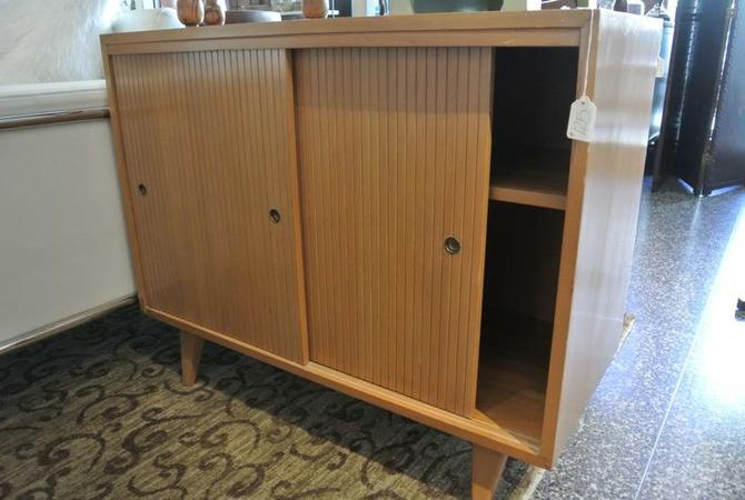 Blonde MCM cabinet with sliding doors. $125