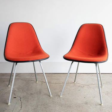 Vintage Pair of Eames for Herman Miller Orange Upholstered Dinning Shell Chairs With Dark Gray Fiberglass Circa 1960 by GoodWilson