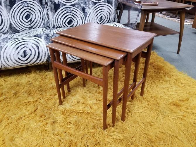 Set of three Danish Modern teak nesting tables by Povl Dinesen