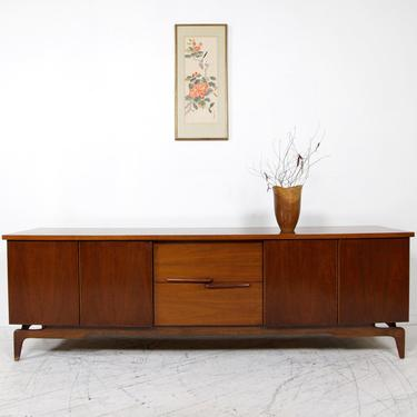 Vintage mcm Young & Co low walnut credenza / sideboard with 2 drawers and sculptural legs | Free delivery in NYC and Hudson by OmasaProjects