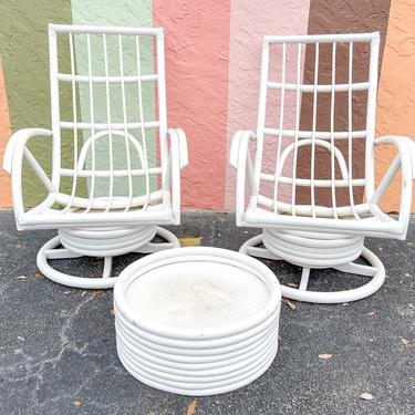 Pair of Rattan Swivel Chairs and Ottoman